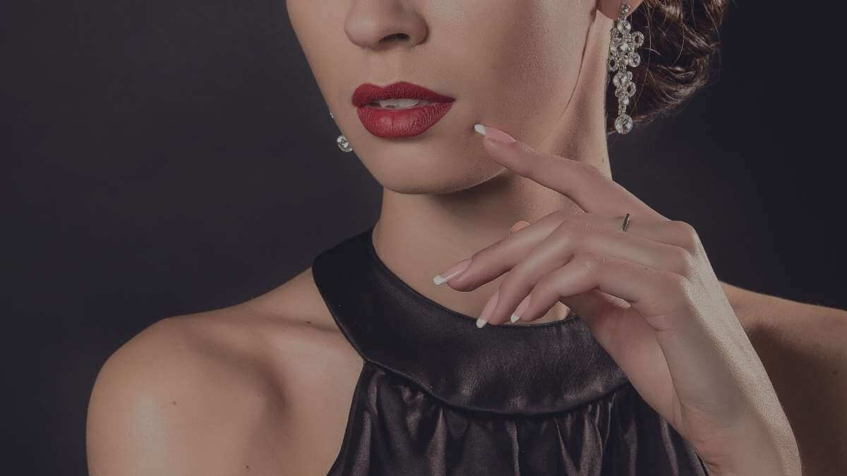 A 'high' class escort wearing expensive dress and jewellery