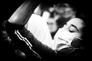 african-american-person-with-tatoo-participaing-in-black-lives-matter-during-protest-coronavirus