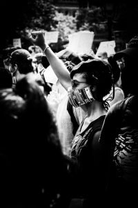 african-american-woman-in-mask-during-the-coronavirus-at-black-lives-matter-protest-in-city