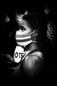 african-american-woman-wearing-a-mask-at-a-black-lives-matter-protest-during-the-coronavirus