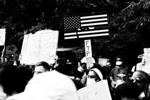 american-flag-and-group-of-black-and-white-people-at-black-lives-matter-protest-during-the-corona-virus-in-city