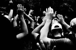 group-of-people-with-hands-raised-during-the-corona-virus-at-black-lives-matter-protest-in-city