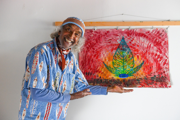 Mohan with his painting.