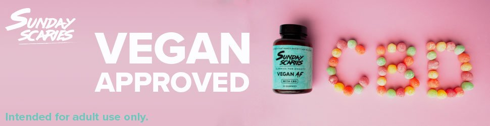 The text vegan approved on a banner with a bottle of gumdrops and gumdrops spelling out CBD.